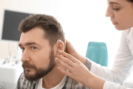Inserting hearing aid_AS 1080-720